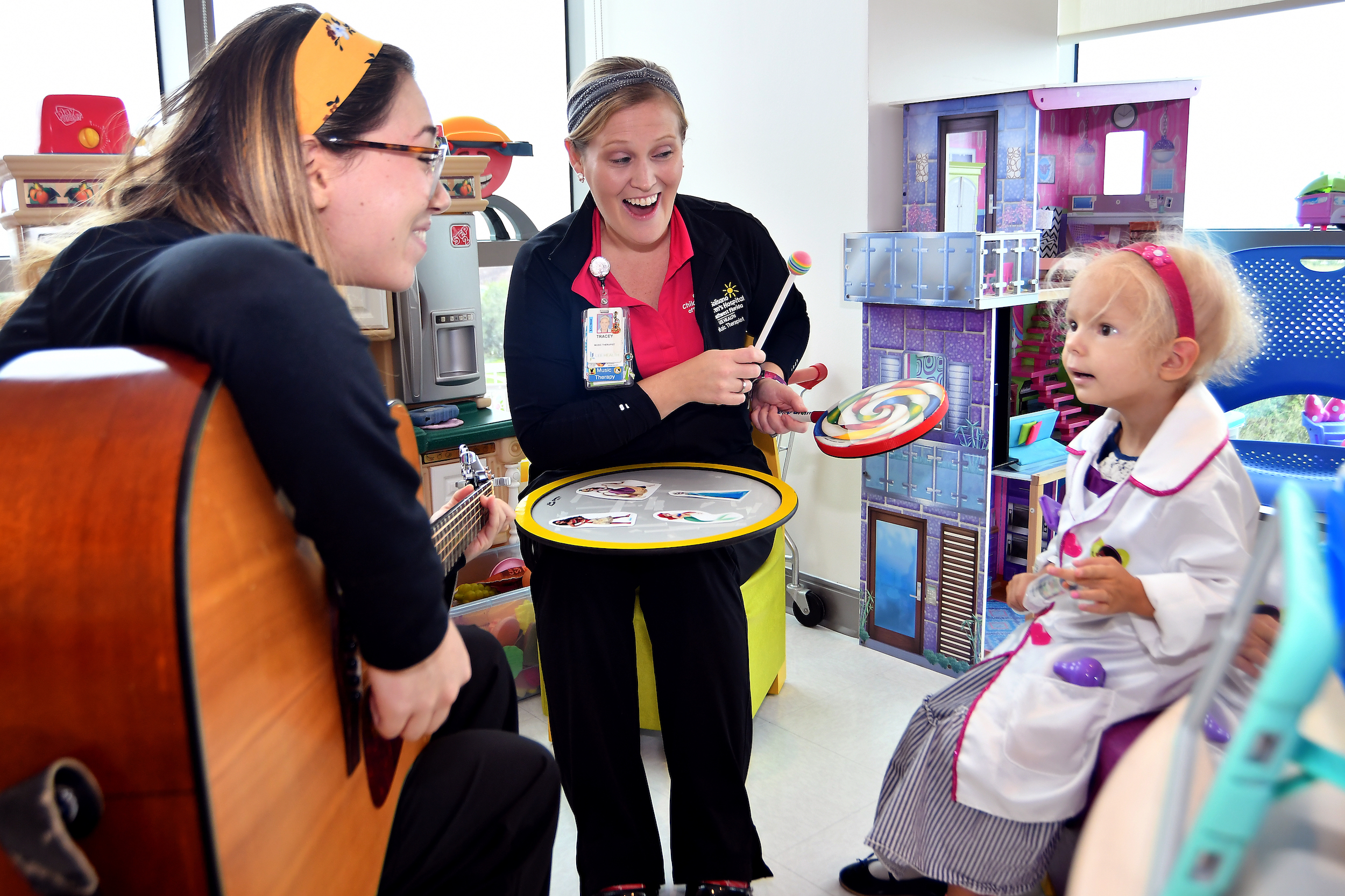 Florida State University Music therapy internEmily Offenkrantz and Tracey Failla center and FGCU intern works with a patient Milda Chartier  age 3 at Golisano Children's Hospital of SWF in Fort Myers ,Wednesday, Nov. 13, 2019. (Chris Tilley Photo/Chris Tilley)