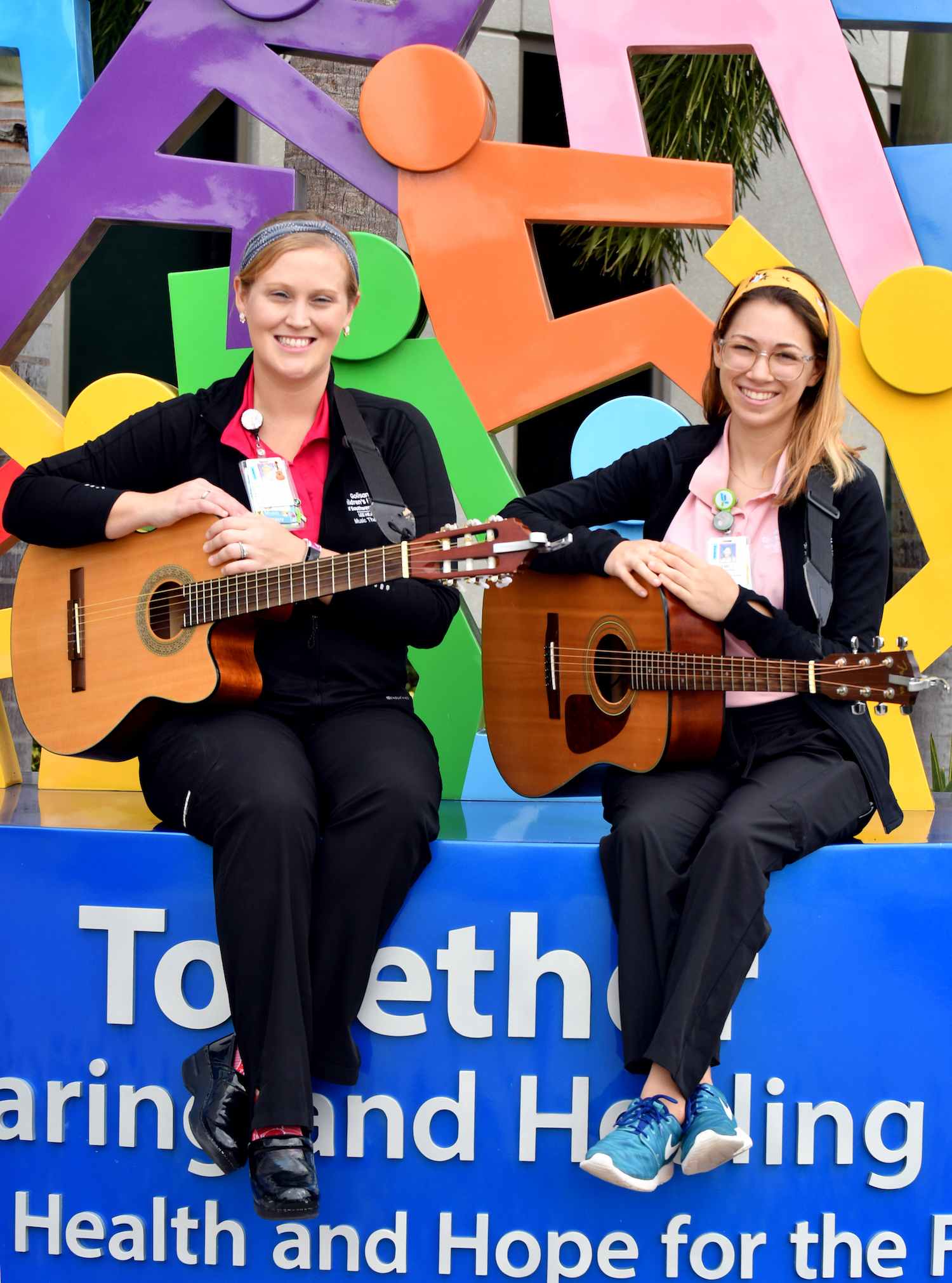 Tracey Failla center and  Florida State University Music Therapy intern Emily Offenkrantz at Golisano Children's Hospital of SWF in Fort Myers ,Wednesday, Nov. 13, 2019. (Chris Tilley Photo/Chris Tilley)